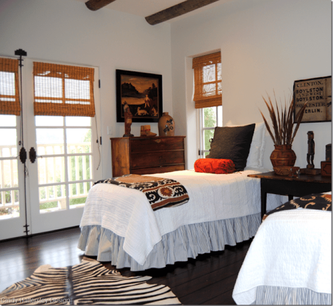 guest bedroom with folk art