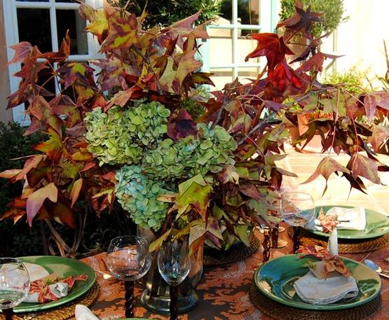 floral arrangement of hydrangea and fall leaves