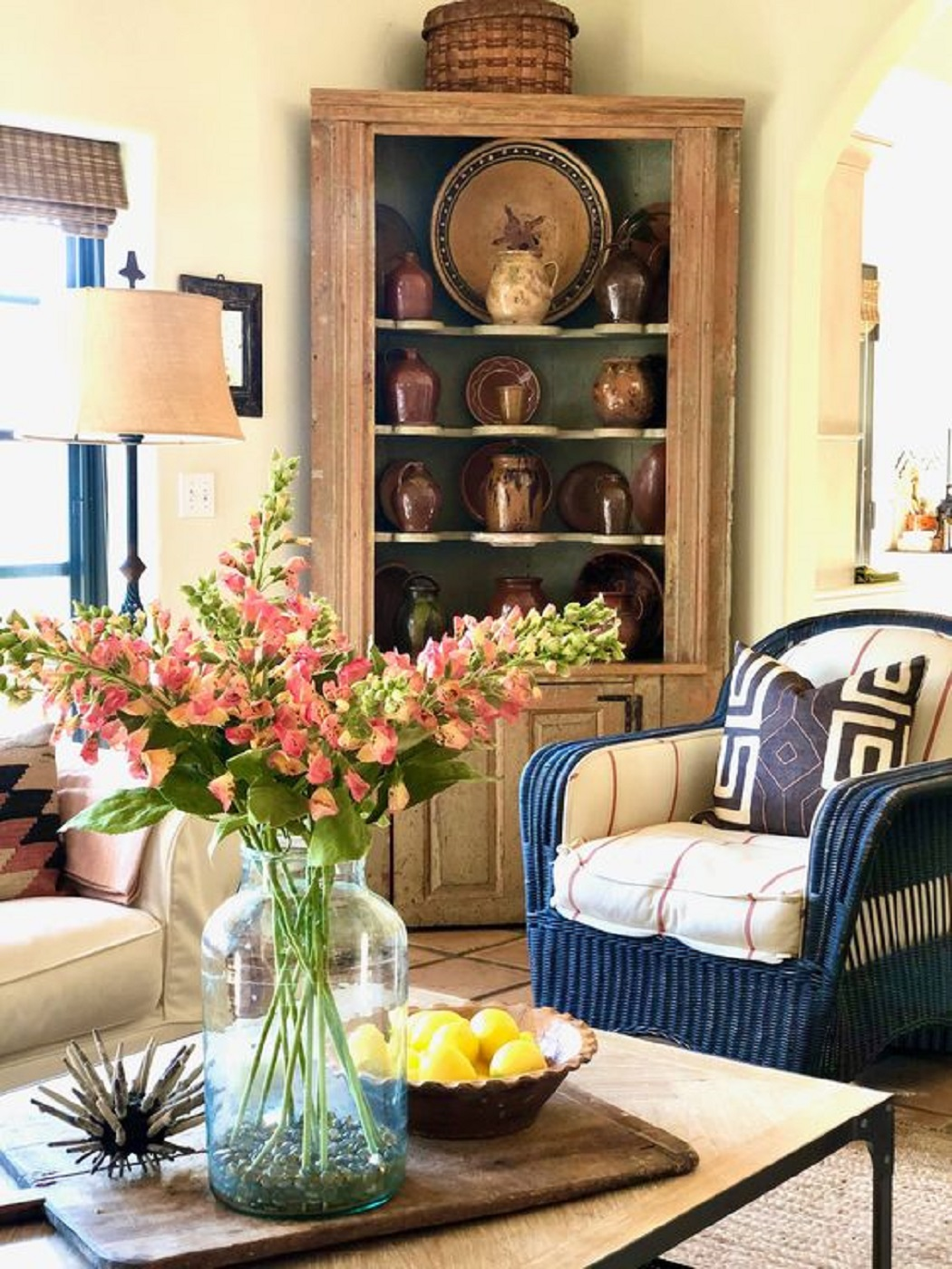 designer cindy hattersley's family room with antique corner cupboard