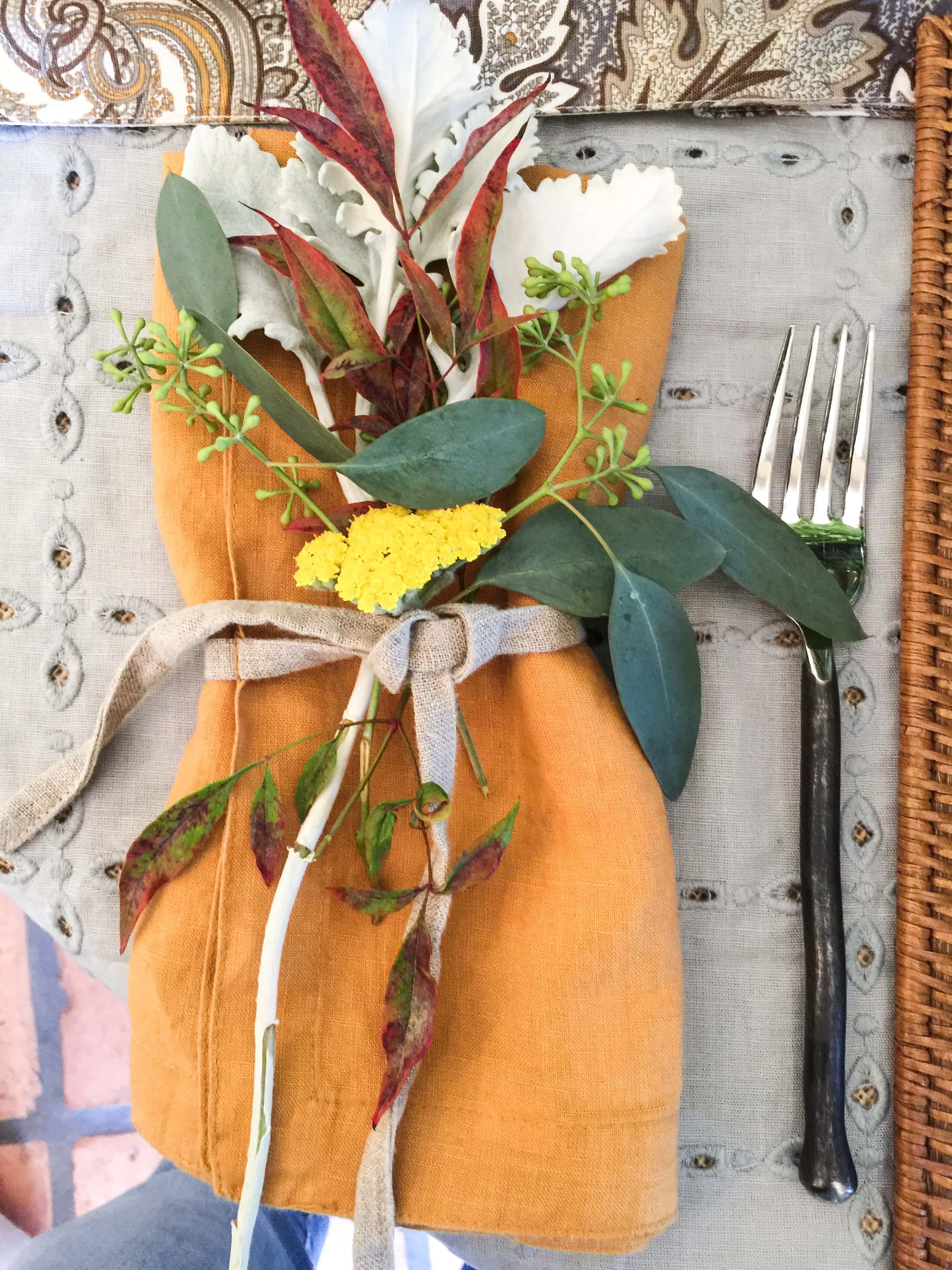 Gorgeous orange cloth napkin and fall floral for fall tablescape