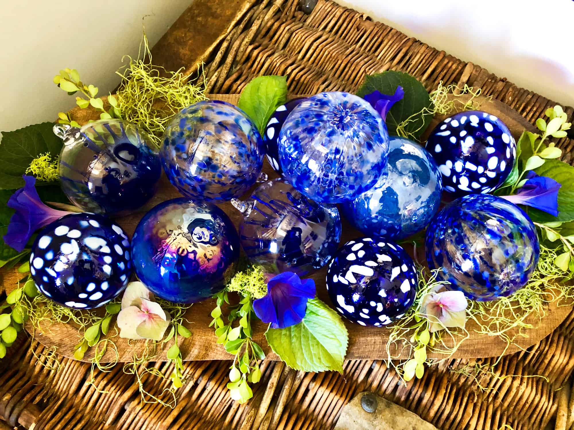 blue ornaments in wood bowl