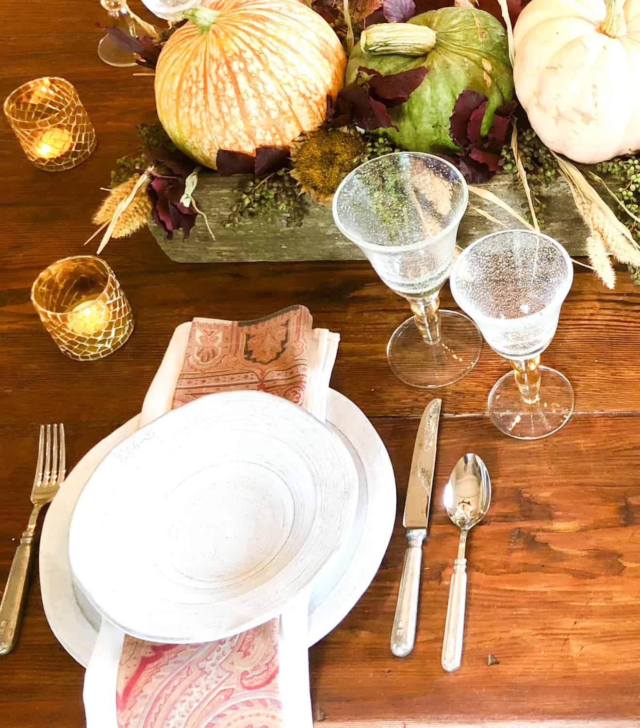 tablescape with pumpkins, sunflowers, privet, wheat