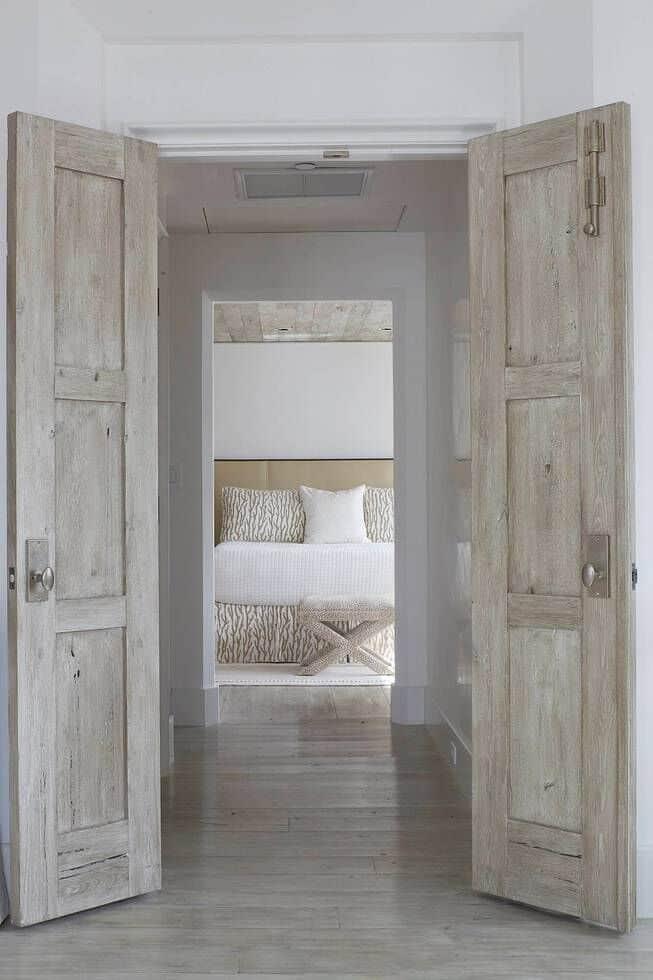 bedroom with reclaimed wood doors