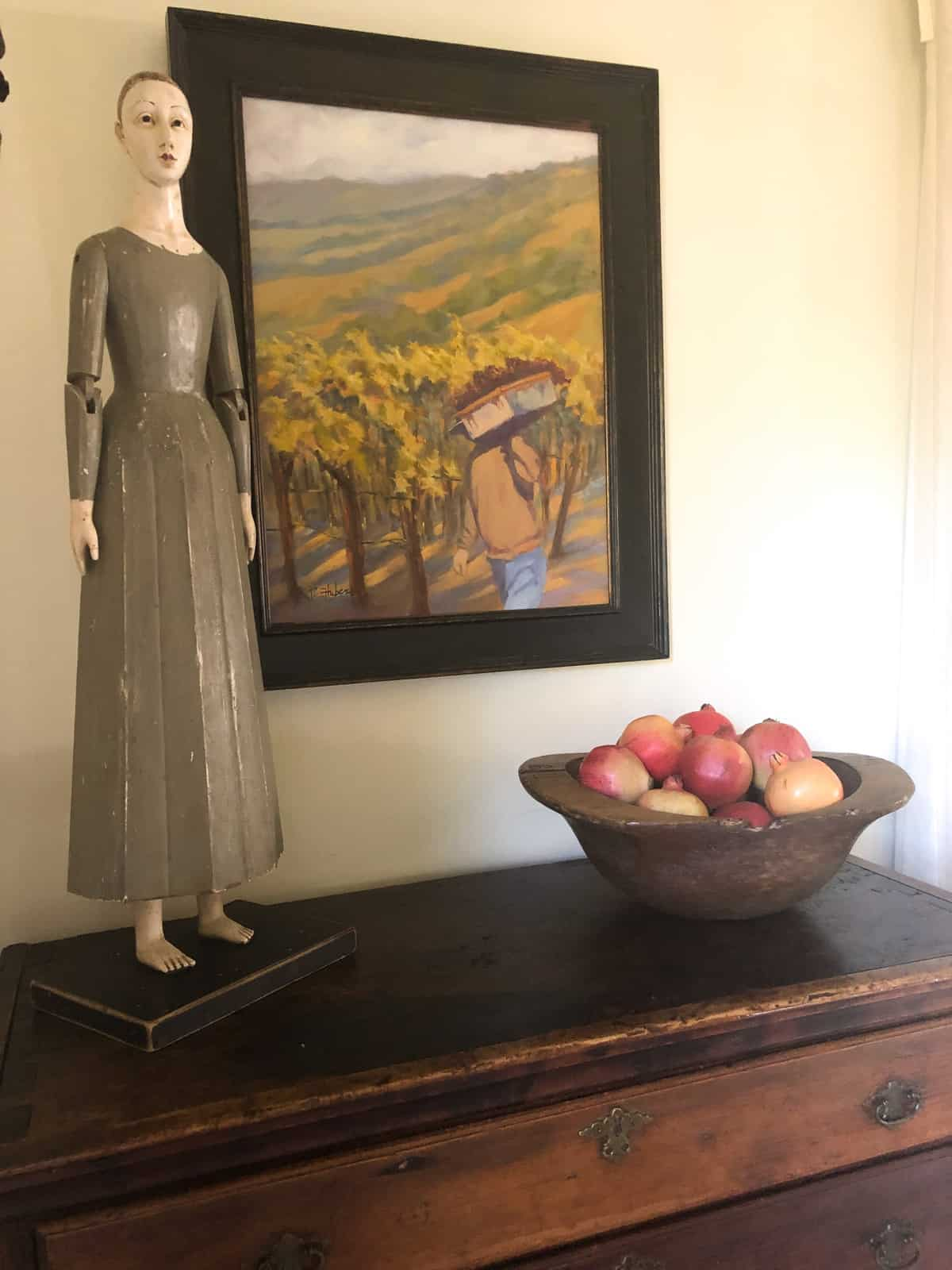 vineyard painting, santo and bowl of fruit