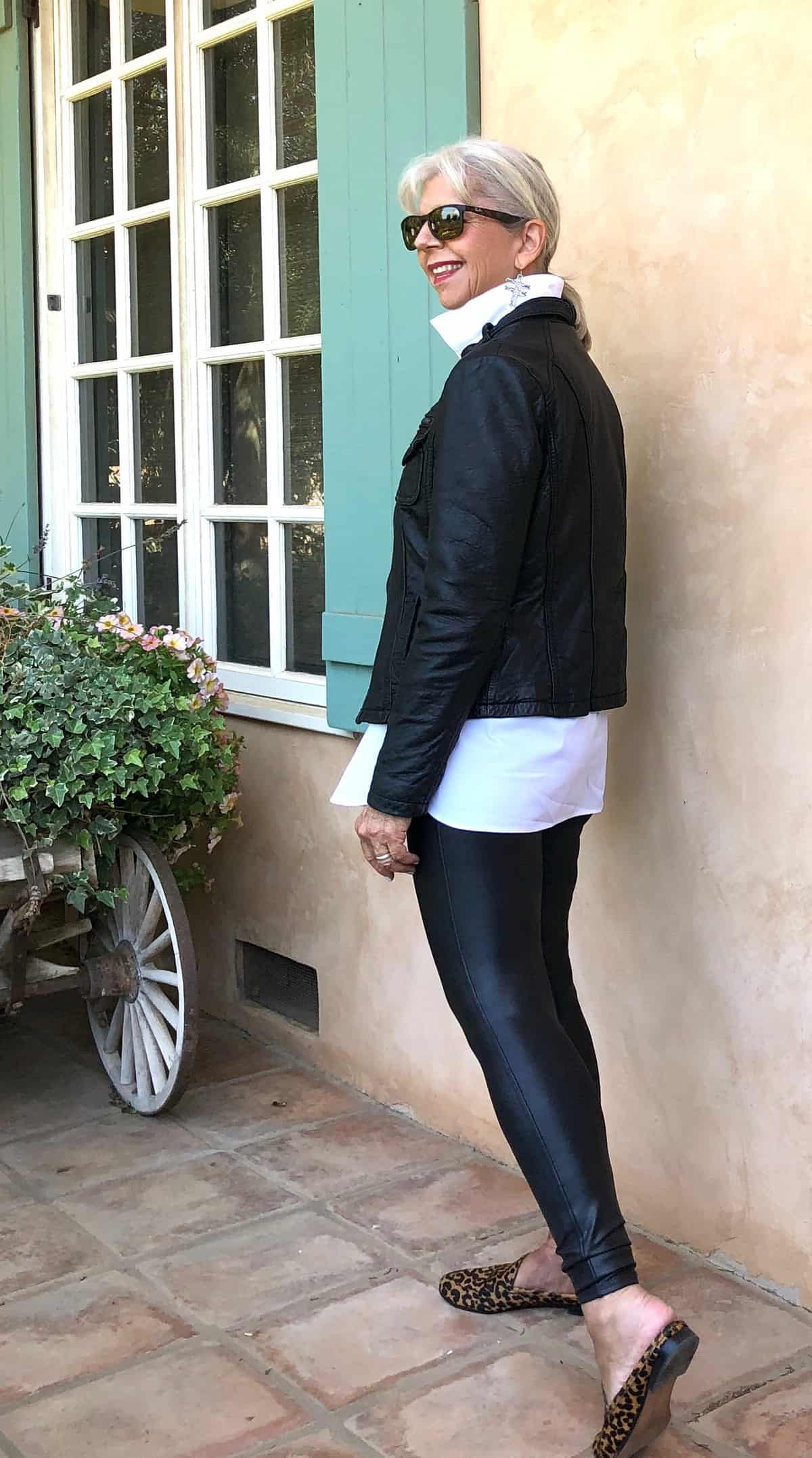 cindy hattersley in black moto jacket, chicos shirt, and spanx leggings