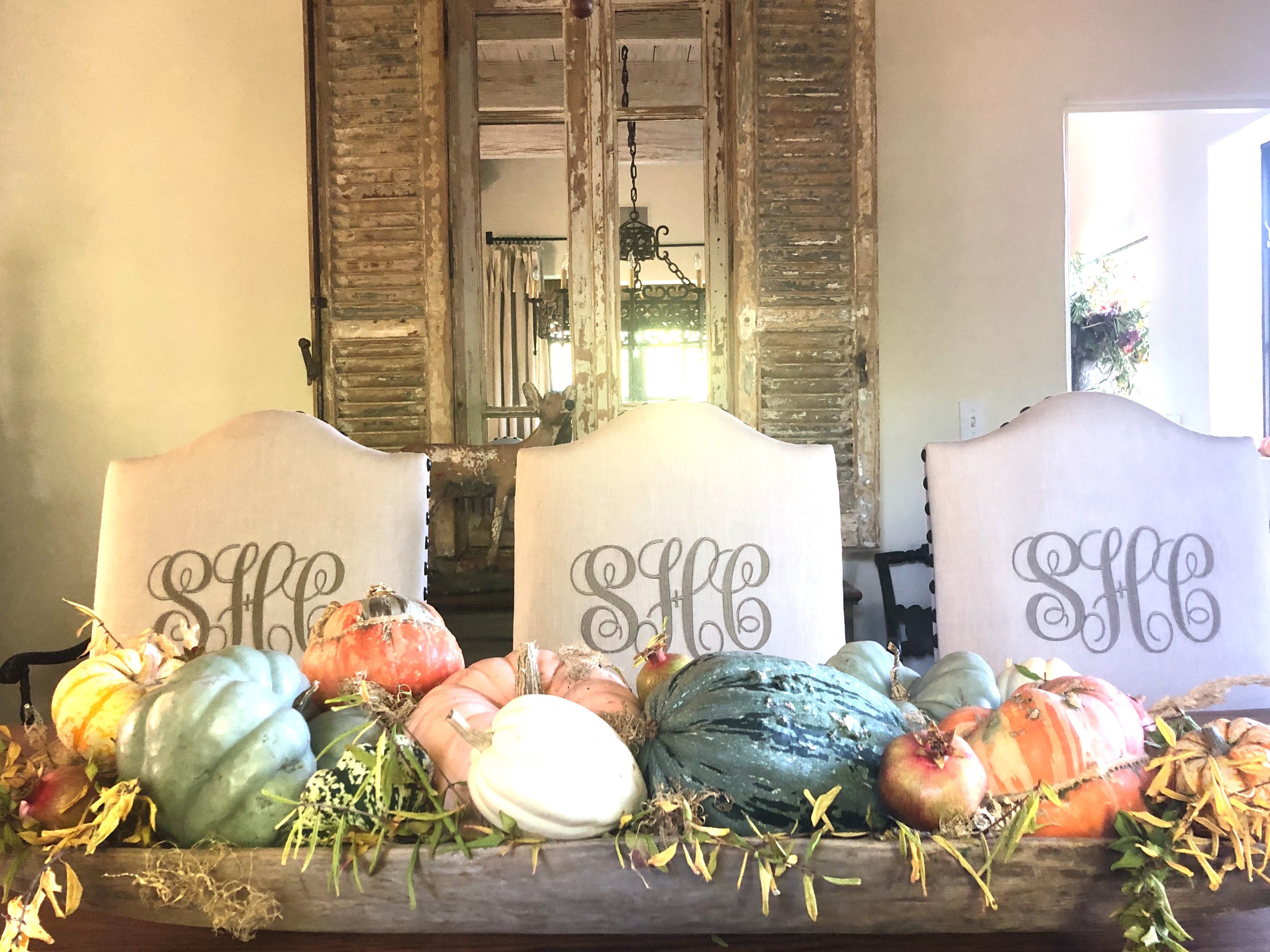 antique dowl bowl with pumpkins and monogram chairs