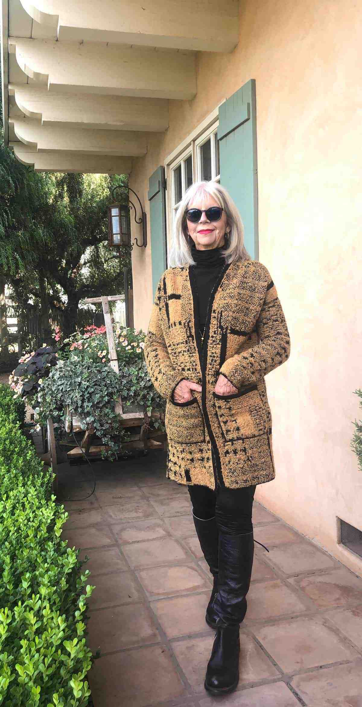 cindy hattersley wearing the peruvian connection jolie coat with black