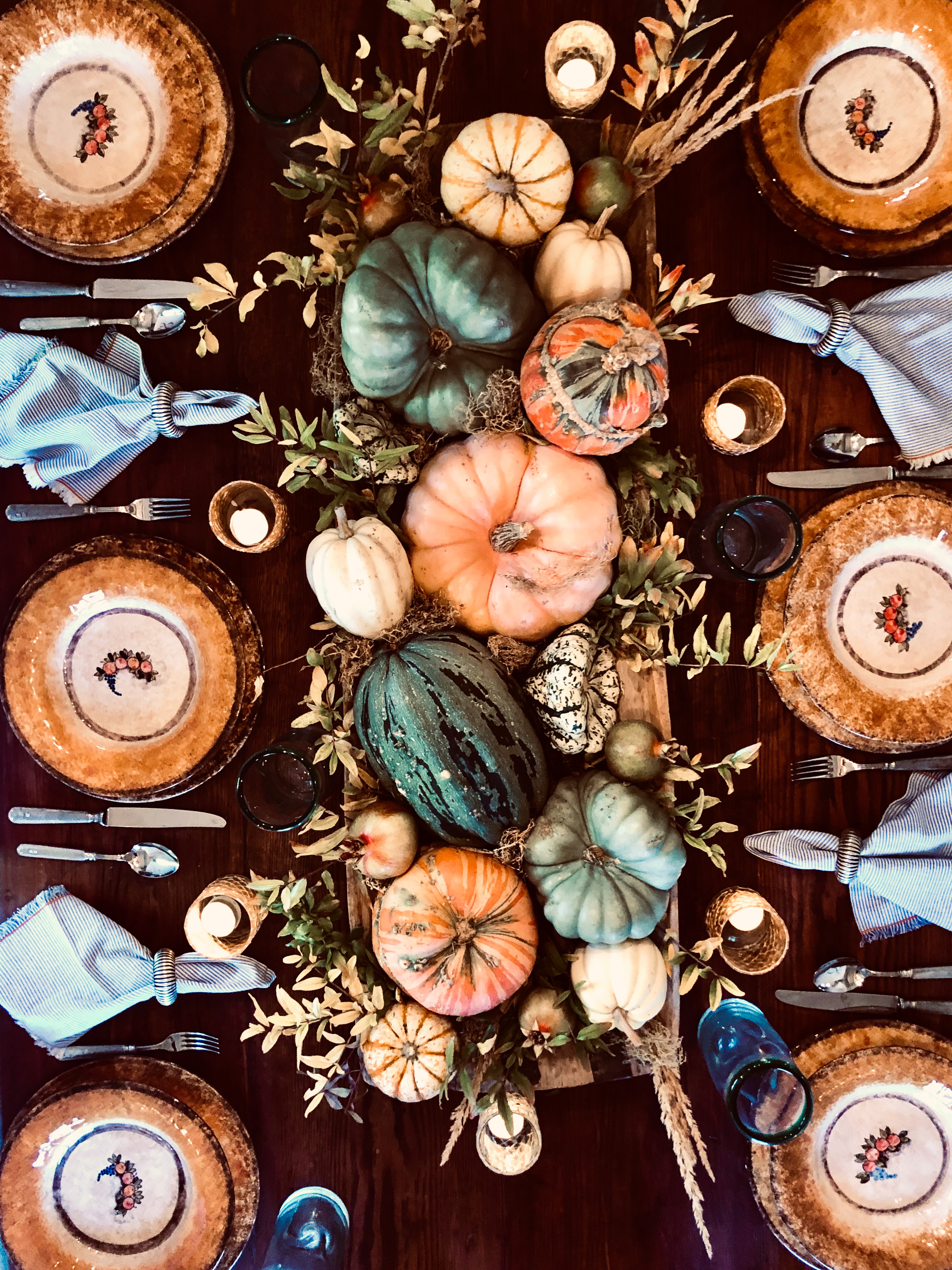 fall tablescape with autumn tableware and pumpkins