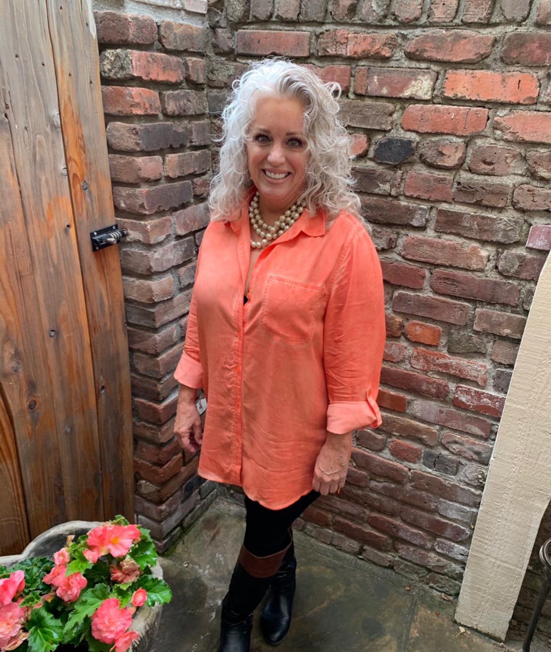 susan remey dakis in orange tunic