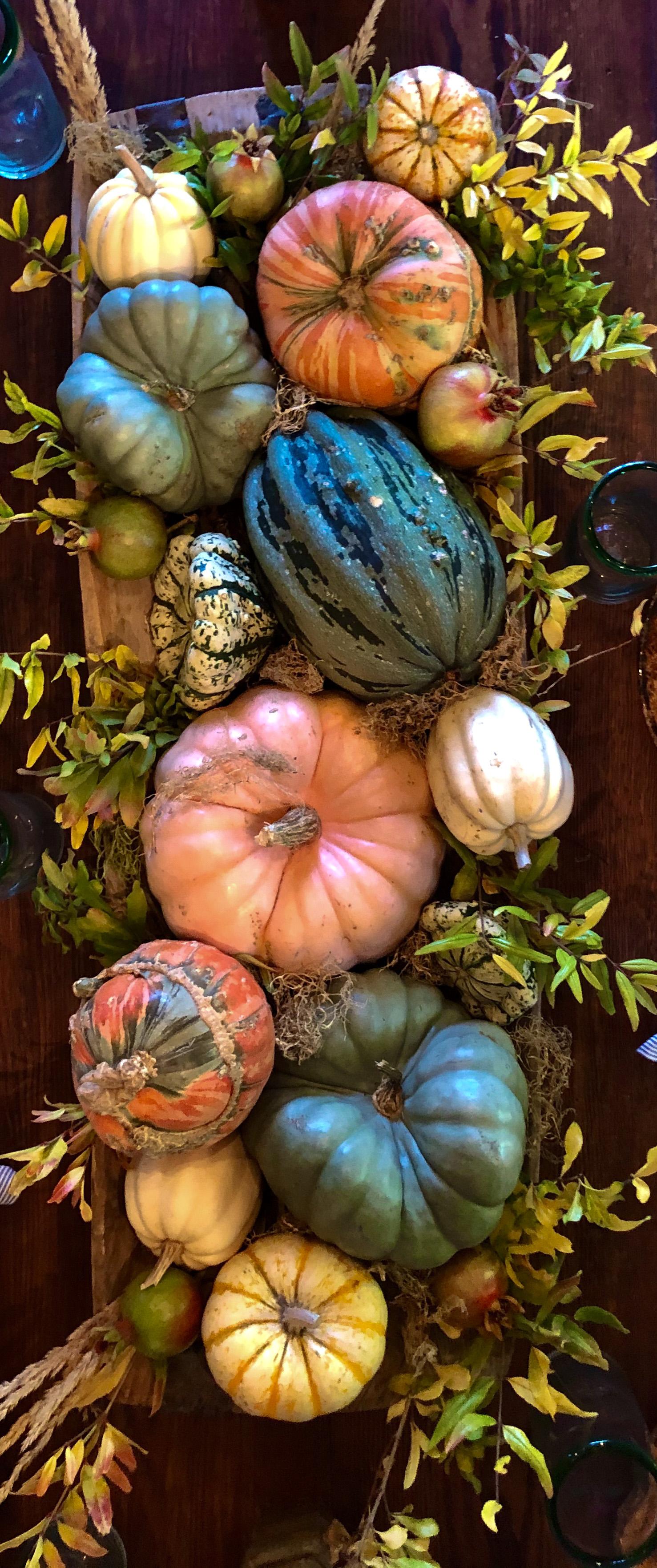 wood dough bowl with cinderella pumpkins