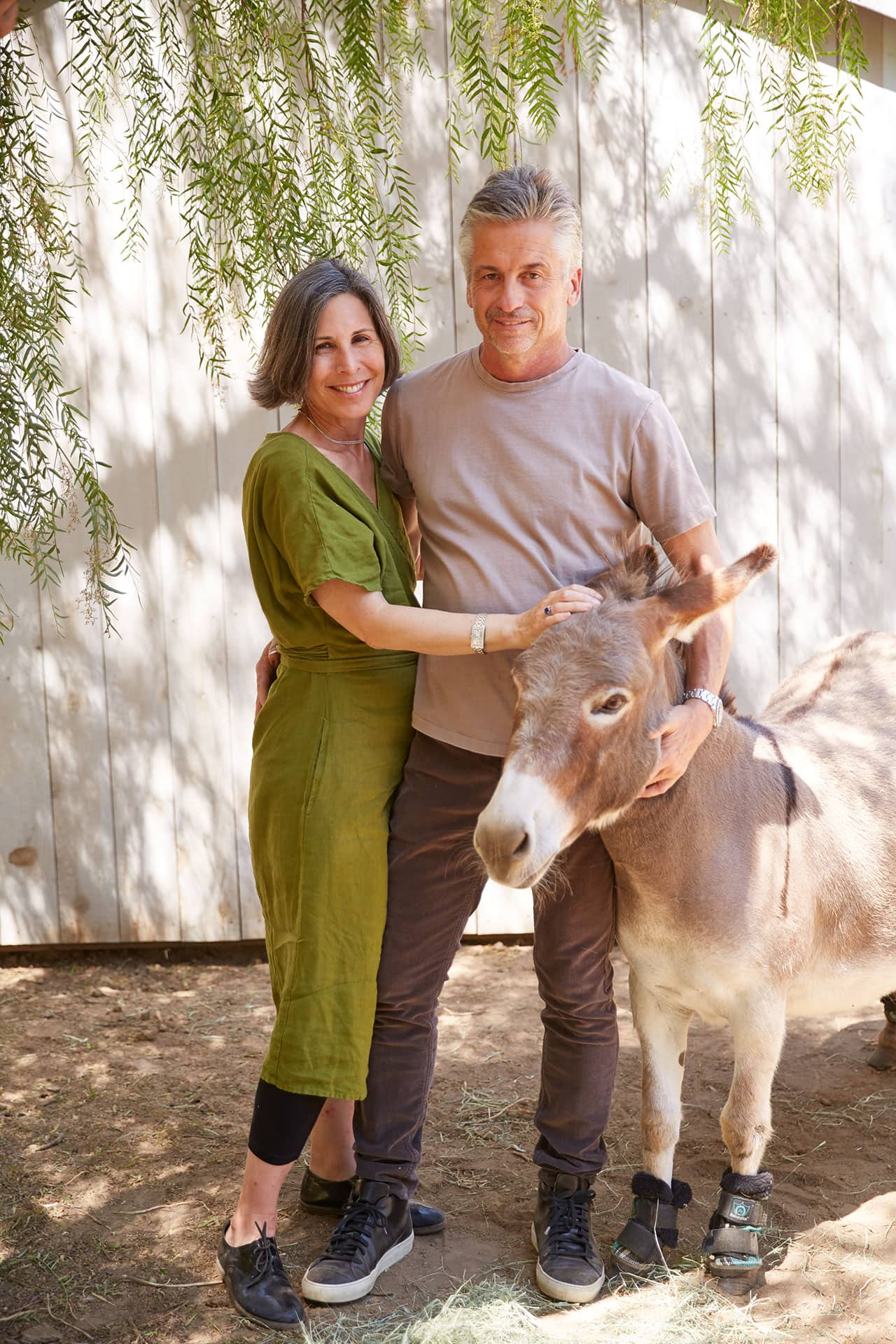 brooke and steve giannetti with one of their donkeys