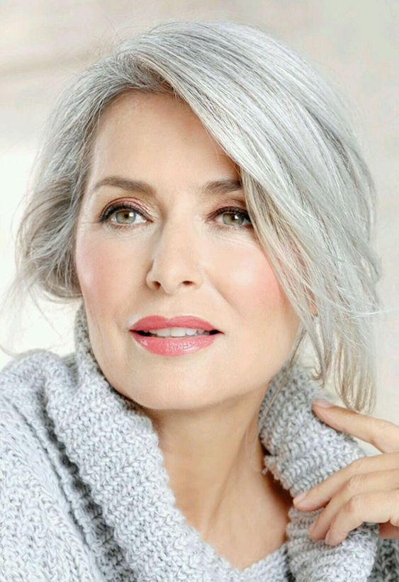 beautiful woman with gray hair and rosy makeup