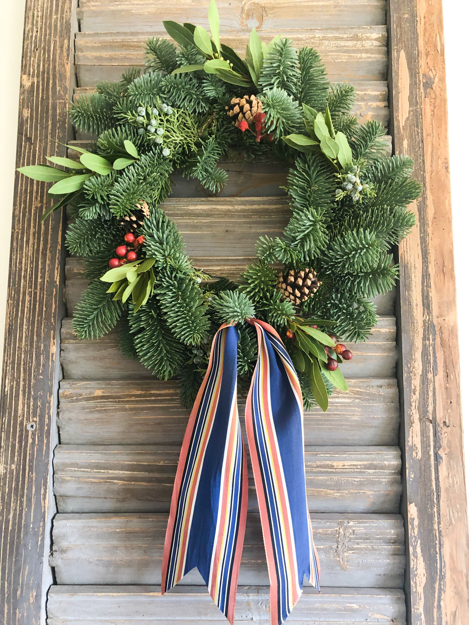 trader joe's wreath on old shutter with vintage ribbon