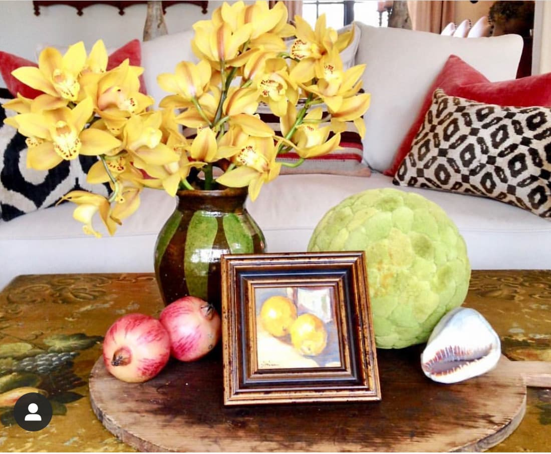 cindy hattersley design coffee table with breadboard and art