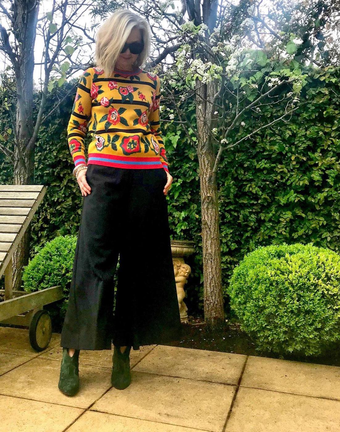 Sarah London in black culottes
