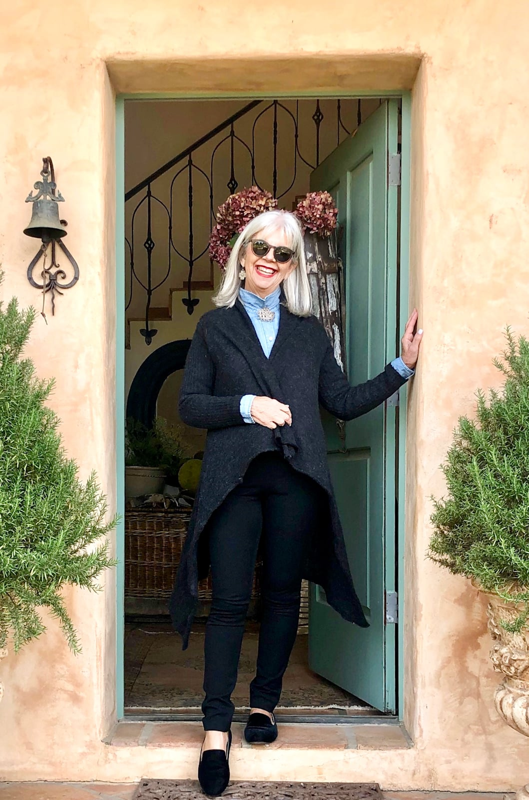 over 50 fashion blogger cindy hattersley in black drapefront sweater and banana republic pants