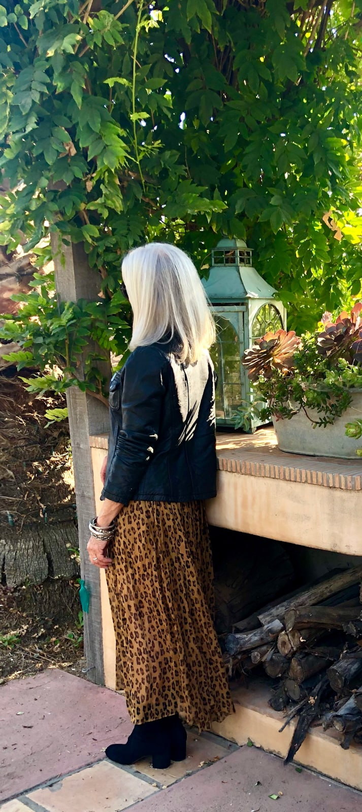 cindy hattersley in free people leopard skirt and leather jacket