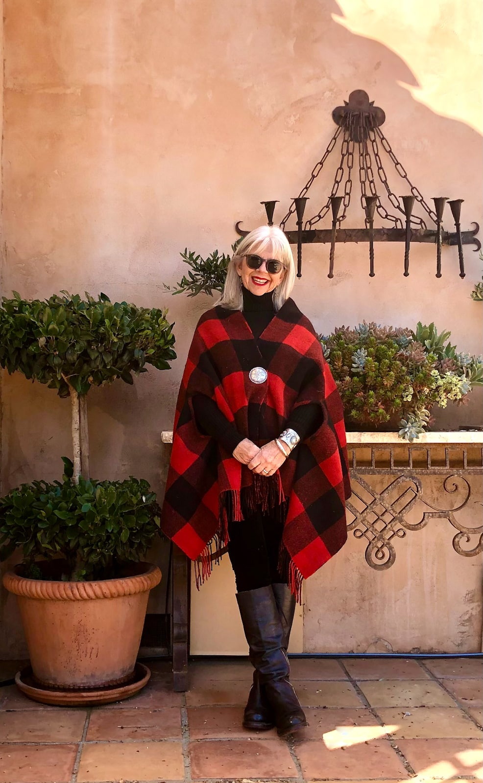 CINDY HATTERSLEY IN EILEEN FISHER LEGGINGS AND RED AND BLACK PONCHO