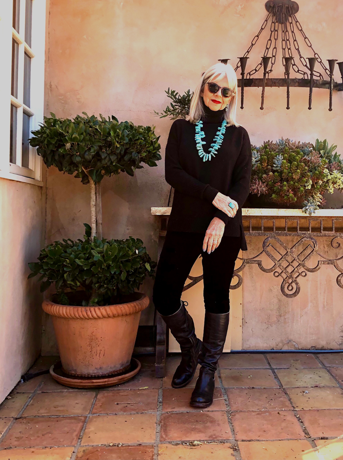 CINDY HATTERSLEY IN J CREW SWEATER AND EILEEN FISHER VELVET LEGGINGS