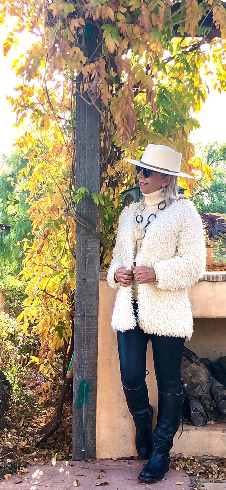 cindy hattersley in ibu movement medusa shawl and spanx faux leather leggings