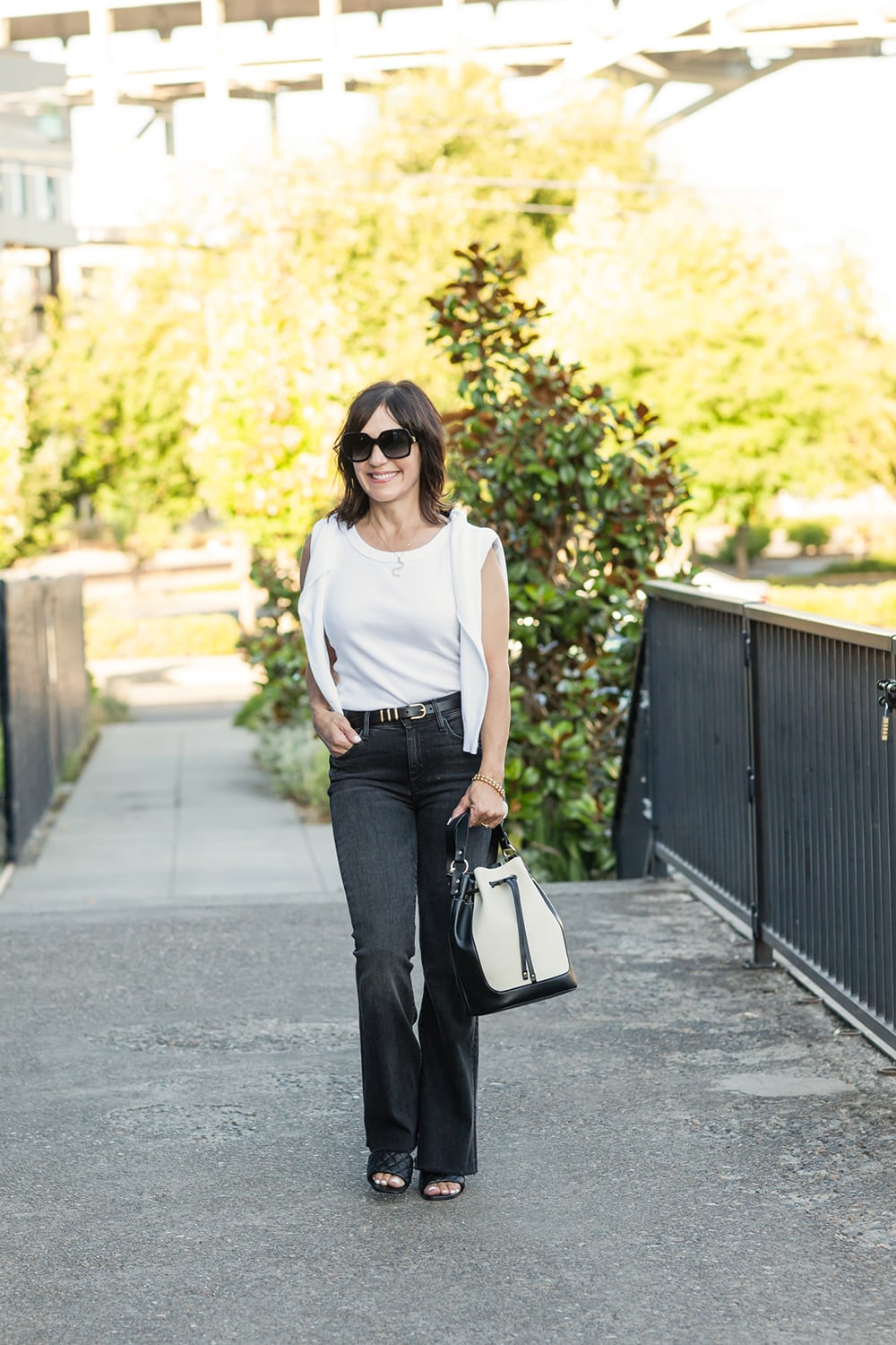 susie wright in black jeans and white tee