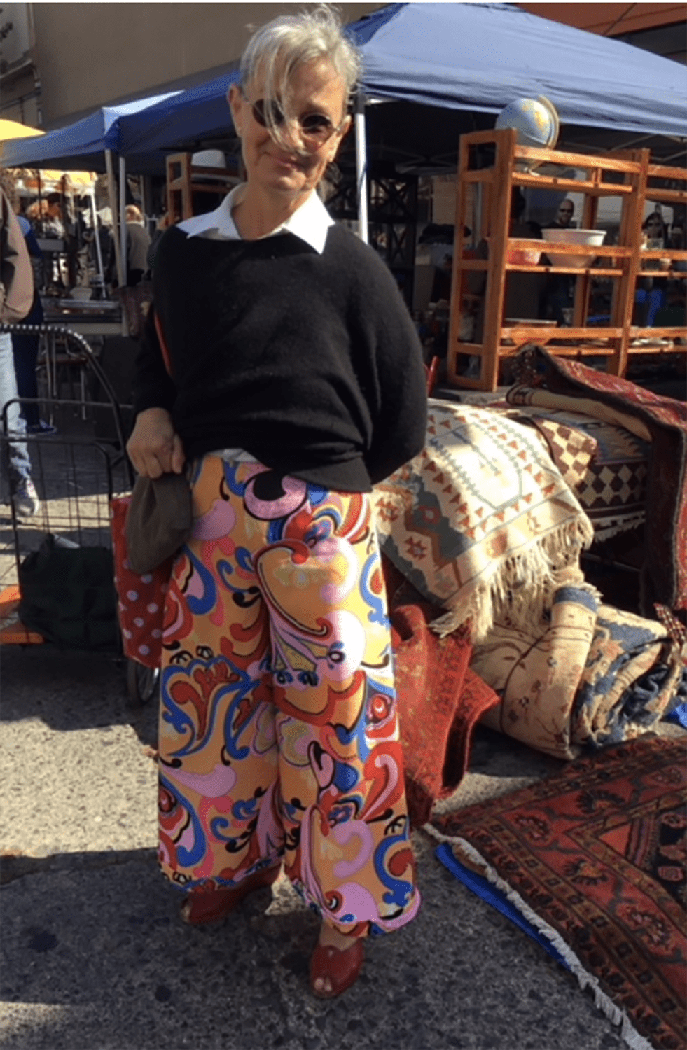 chic older woman in palazzo pants