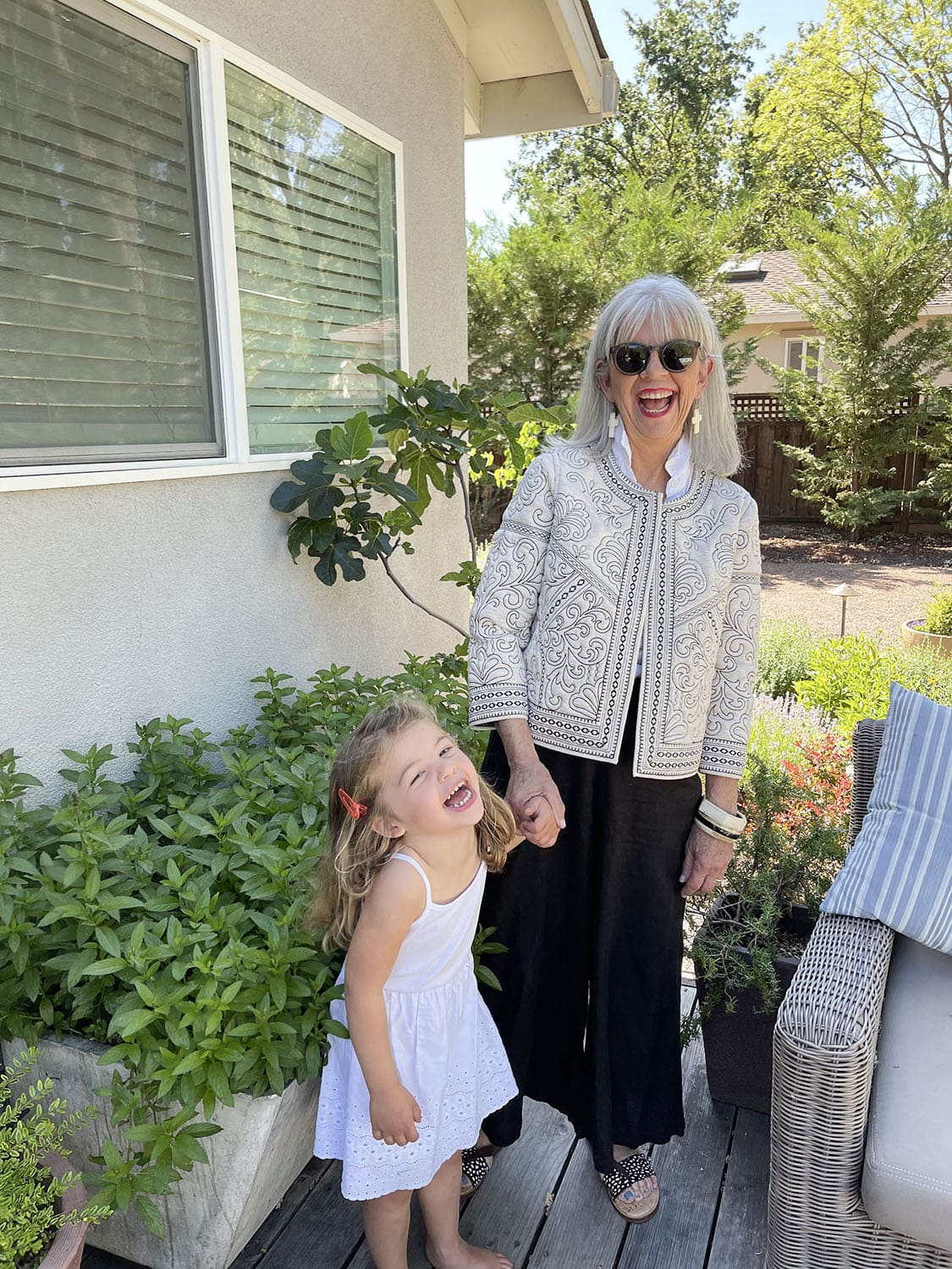cindy hattersley in Anthropologie jacket, cp shades & J Crew with granddaughter Summer
