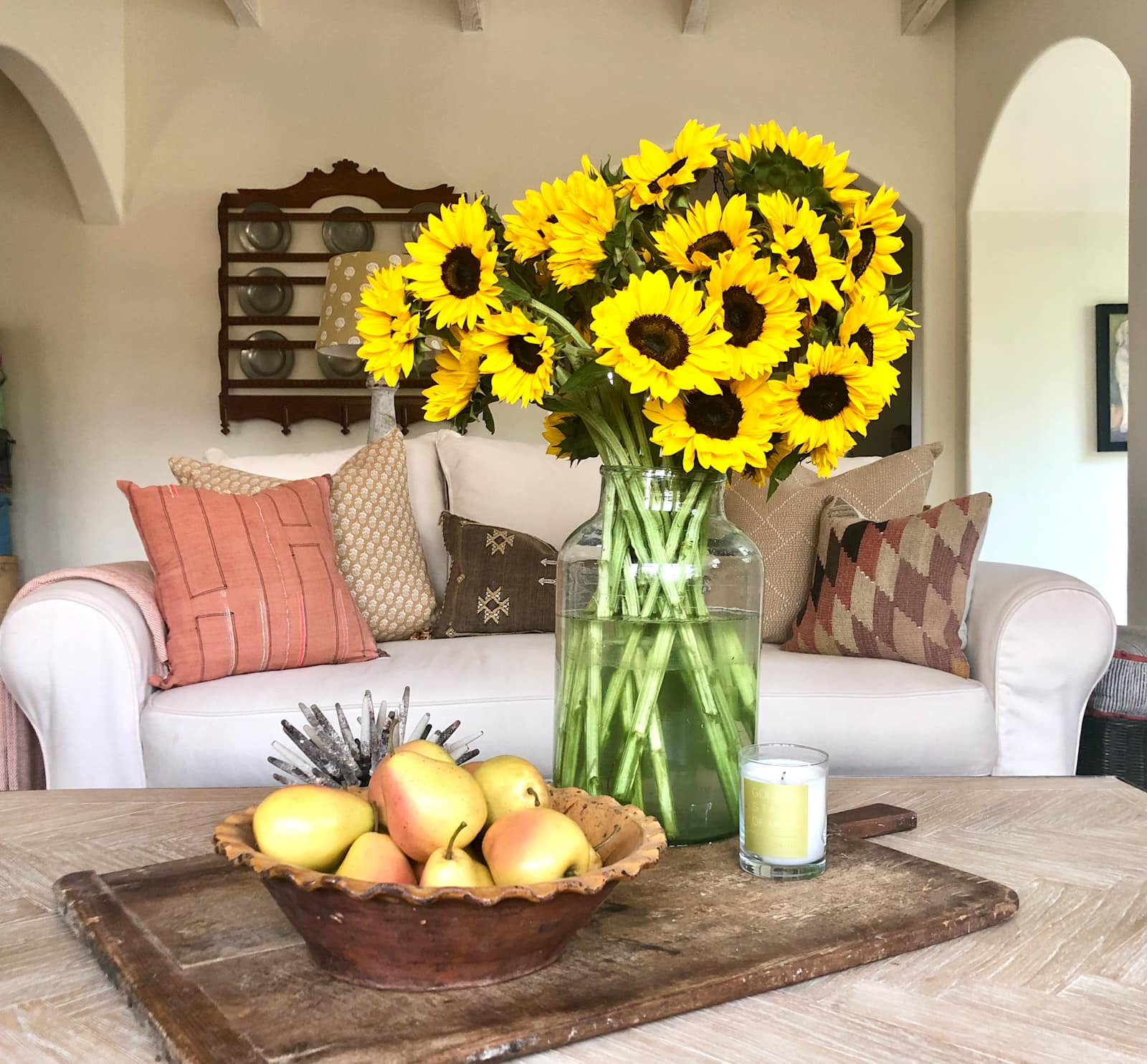 cindy hattersley's coffee table with sunflowers and pears