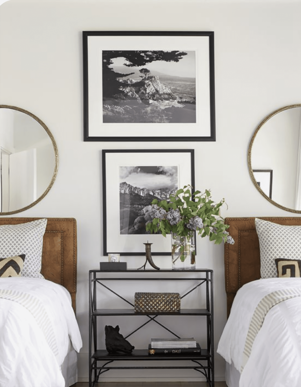 andrew brown designed bedroom with matching mirrors
