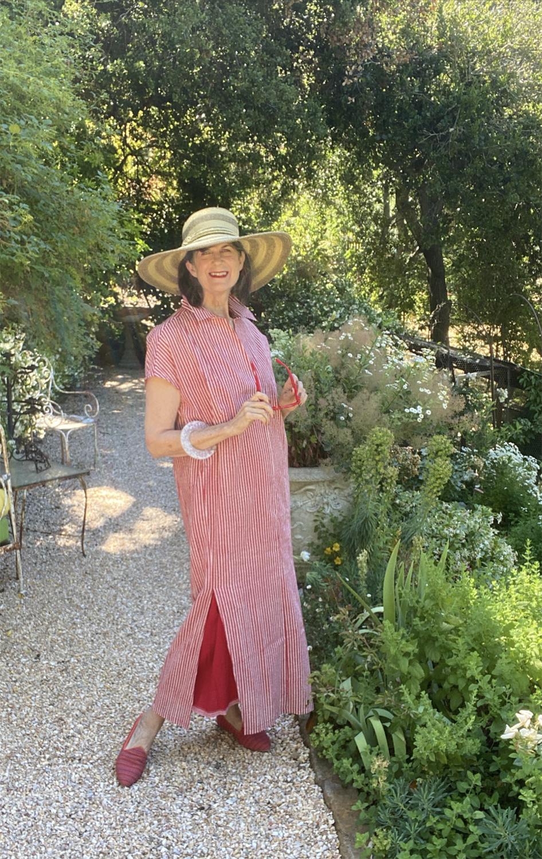 ELIZABETH THE CONTESSA IN RED IN HER GARDEN