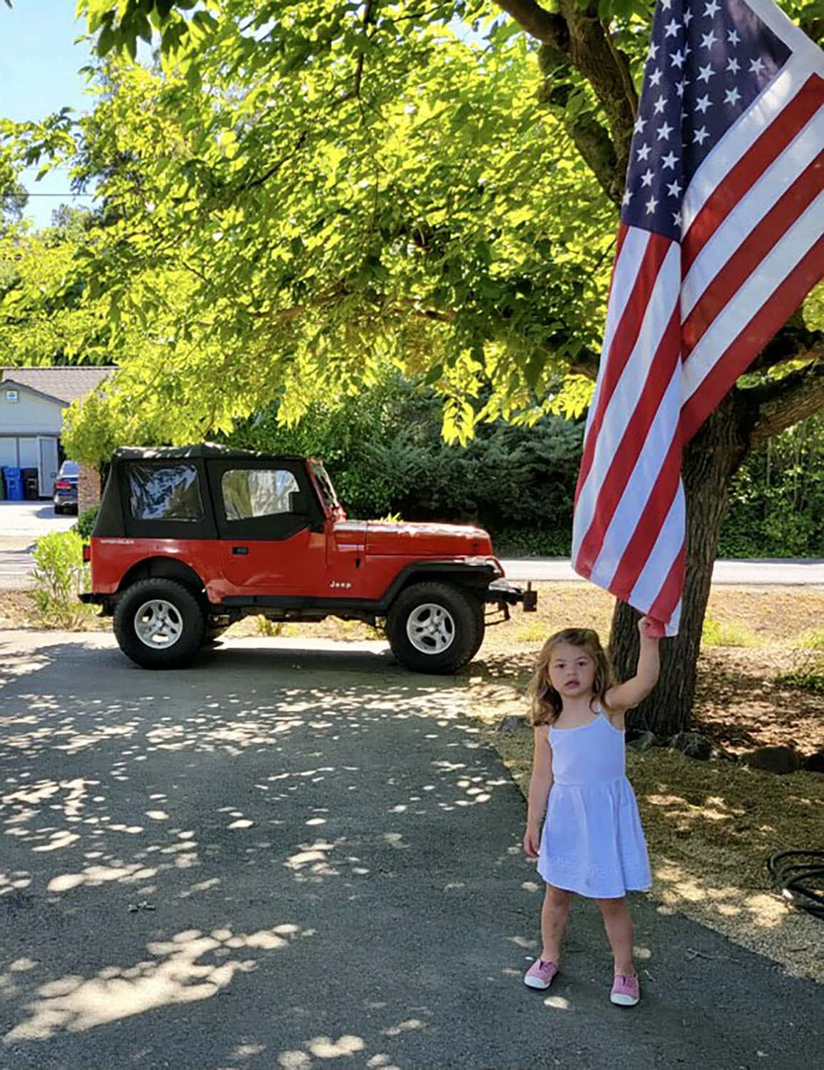 Cindy Hattersley's granddaughter Summer with the flag