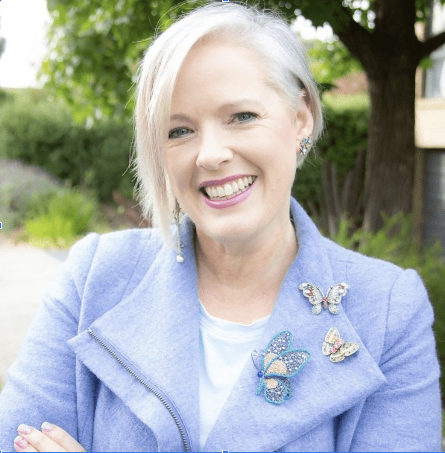 Image Consultant Imogen Lamport in blue jacket with brooches