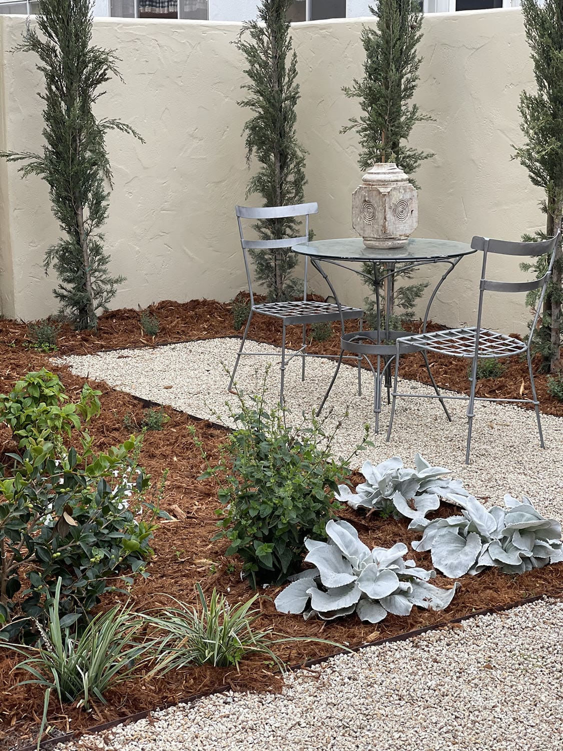 backyard pathway with table and chairs