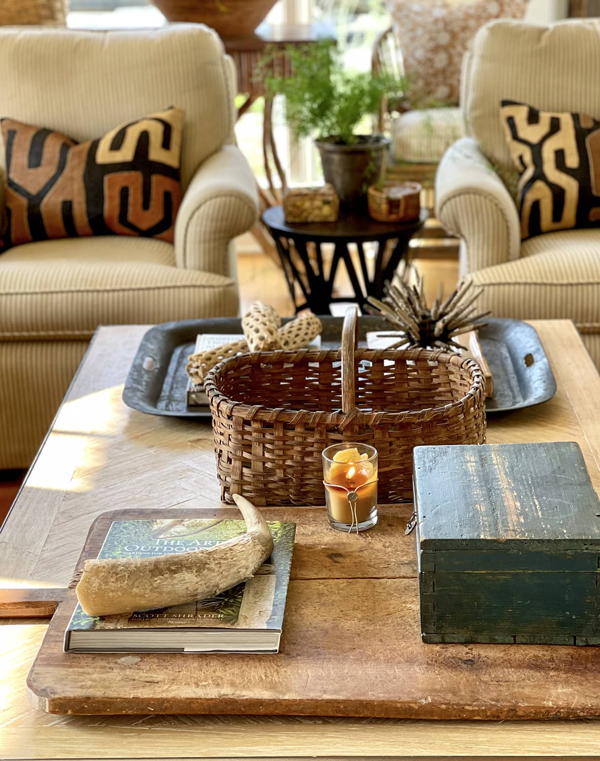 cindy hattersley's fall coffee table and chairs with kuba cloth pillows