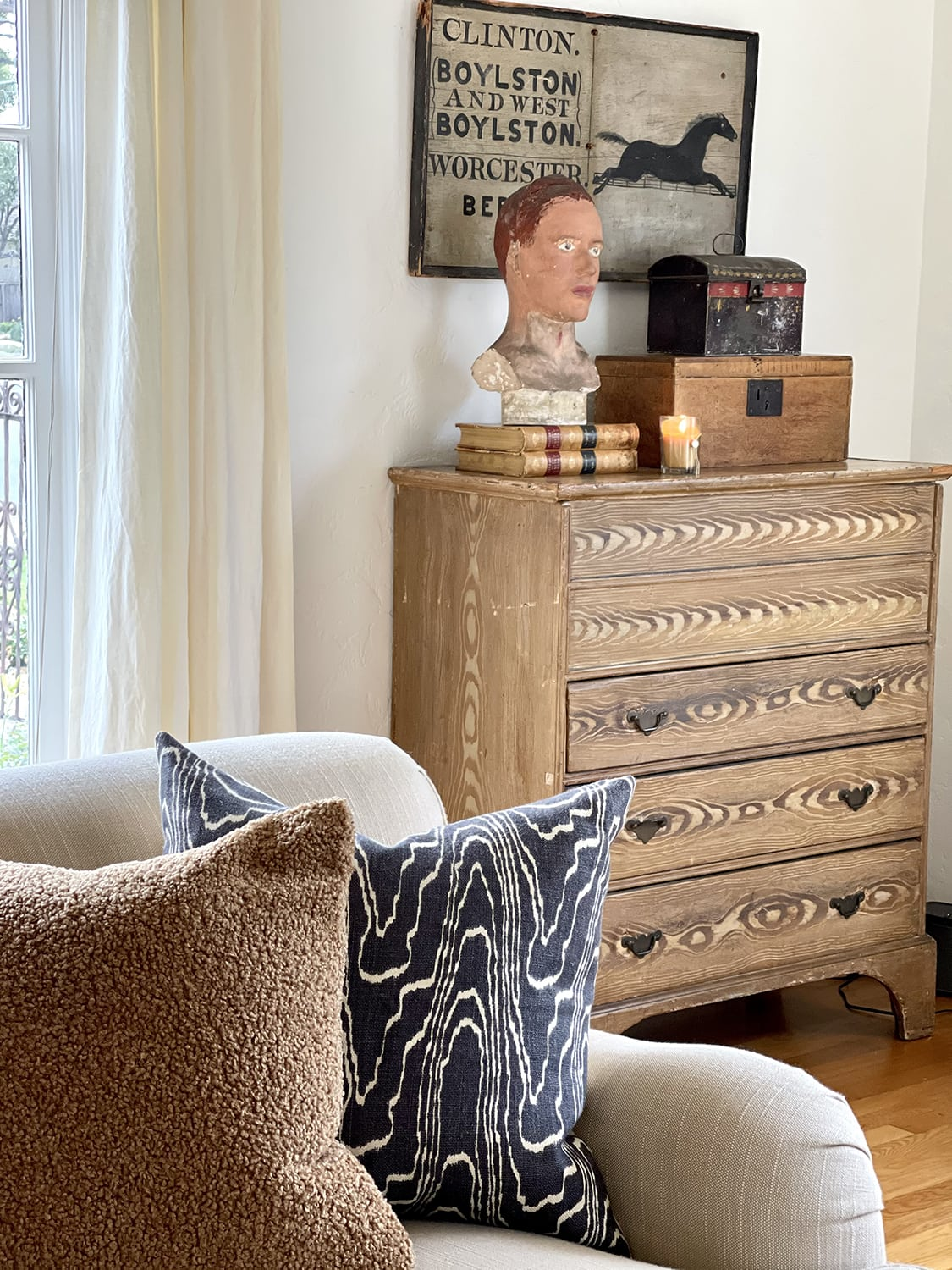 American grained chest vignette and sofa pillows